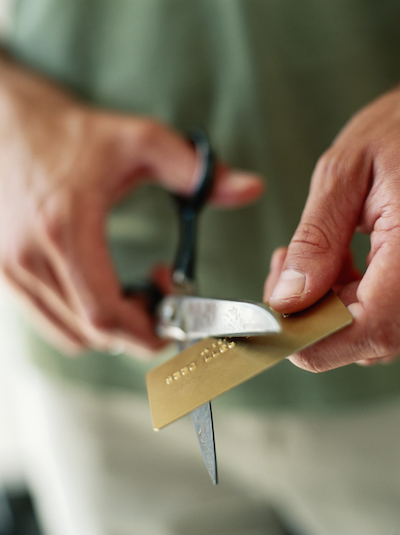 Man cutting up credit card, close-up