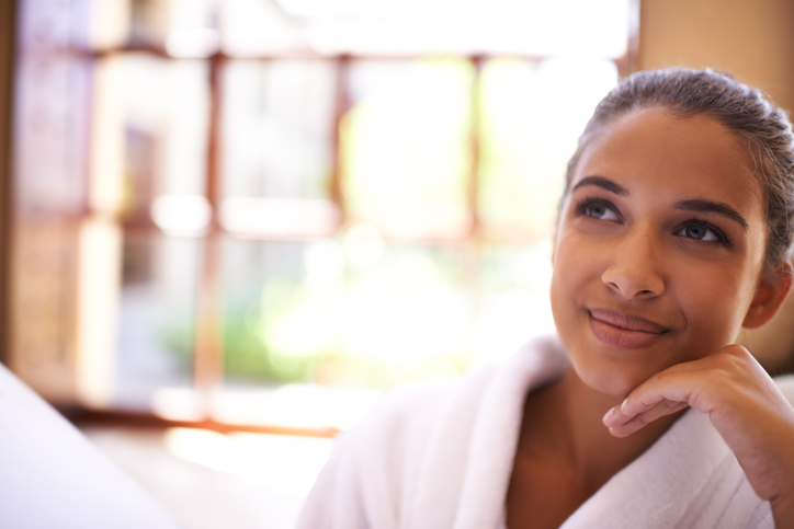 Young woman looking thoughtful while at a health spa.